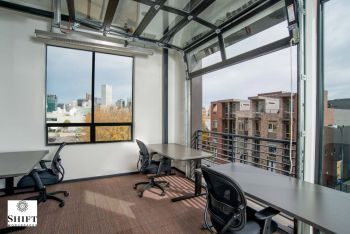 Corner Office With Garage Door Features Views Of Downtown Denver